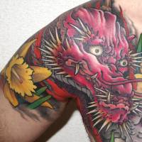 John Monday, Writer, 39 (Welsh): I'm from Wales, where the national emblems include daffodils and dragons. So this tattoo is a way to remember my roots and a reminder, each morning, to thank the Lord I'm Welsh. It took 10 hours from Tomo at Yellow Blaze.