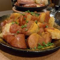 Wurst über alles: The popular Berlin street dish currywurst is available at German-style pubs such as Kaiserhof and as takeout at König. | REBECCA MILNER