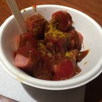 Wurst über alles: The popular Berlin street dish currywurst is available at German-style pubs such as Kaiserhof and as takeout at König.   REBECCA MILNER