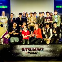 Award winners and BitSummit organizers pose with Kyoto mascot Mayumaro. | DYLAN CUTHBERT