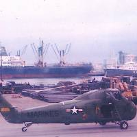 Loaded: A U.S. Marine Corps helicopter sits by unidentified barrels at Naha Military Port in the late '60s. | COURTESY OF MICHAEL JONES