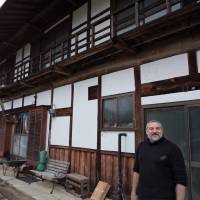 Putting down roots: Euan Craig poses in front of the old farmhouse he renovated with his family in Minakami, Gunma Prefecture. They bought the house after the March 11, 2011, earthquake wrecked their former home in Tochigi. | MAMI MARUKO