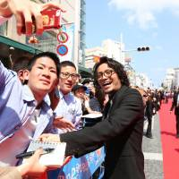 Meet and greet: Relatively light barriers separating stars and their idols meant actors walking the Red Carpet, such as Koki Tanaka (above), could get up close with their fans. | OKINAWA INTERNATIONAL MOVIE FESTIVAL / YOSHIMOTO LAUGH & PEACE