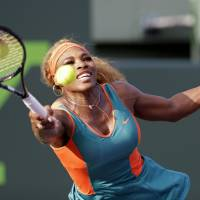 In at the deep end: Serena Williams plays a shot during her 7-6 (9-7), 6-2 win over Kazakhstan's Yaroslava Shvedova at the Sony Open on Thursday. | AP