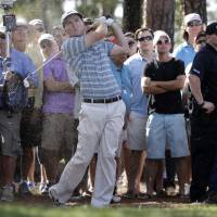 Keep it straight: Russell Henley hits off the eighth fairway during the final round of the Honda Classic on Sunday. | AP