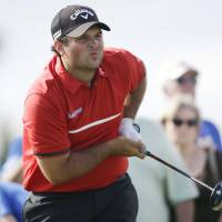 Copycat: Patrick Reed watches his shot on the 11th hole during the final round of the Cadillac Championship on Sunday in Doral, Florida. | AP