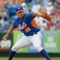 Looking good: New York's Daisuke Matsuzaka fires a pitch against St. Louis at spring training on Monday. Matsuzaka earned the win as the Mets downed the Cardinals 5-3. | KYODO