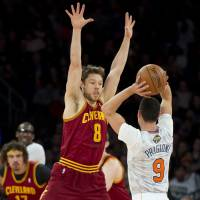 In your face: The Cavaliers' Matthew Dellavedova guards the Knicks' Pablo Prigioni on Sunday in New York. | AP