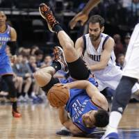Head over heels: Oklahoma City's Steven Adams tumbles during the Thunder's 128-119 loss to the Mavericks on Tuesday. | AP