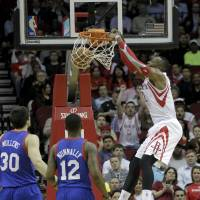 Blast off: Rockets center Dwight Howard dunks against the Sixers on Thursday in Houston. | AP