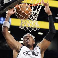 The Truth: The Nets' Paul Pierce dunks during Brooklyn's win over the Timberwolves on Sunday. | AP