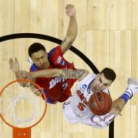 Hoop dream: Florida's Scottie Wilbekin (right) goes to the basket during the Gators' 62-52 win over Dayton on Saturday. | AP