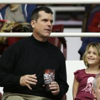 Having fun with Dad: San Francisco 49ers coach Jim Harbaugh sits with his daughter Addison at the Stanford-Utah men's basketball game on Saturday at Maples Pavilion. | AP