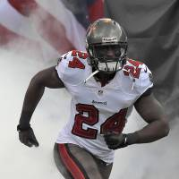 On to bigger and better: Former Buccaneers cornerback Darrelle Revis signed with the Patriots on Thursday.   AP