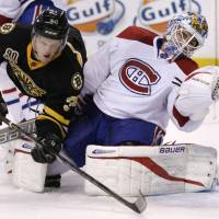 Pressure save: Boston's Carl Soderberg collides with Montreal goalie Peter Budaj in the second period on Monday night. | AP
