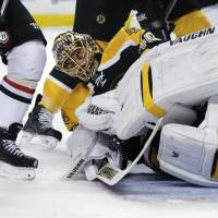 Who dares wins: Boston goalie Tuukka Rask makes a save during the Bruins' 4-2 win over the Capitals on Saturday. | AP