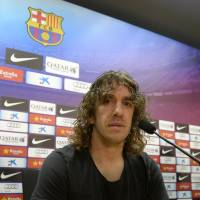 End of the line: Barcelona captain Carles Puyol awaits the start of a news conference on Tuesday where he announced this would be his final season with the club. | AFP-JIJI