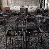 Charred desks and chairs still stand Jan. 22 in a classroom in Kadowaki Elementary School, which was gutted by fire after the March 11 tsunami, in Ishinomaki, Miyagi Prefecture. | KYODO
