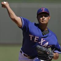 Five frames: Texas starter Yu Darvish delivers a pitch against Cincinnati in the third inning at spring training Monday. The Rangers beat the Reds 8-2. | AP