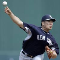 Uneven outing: New York's Masahiro Tanaka fires a pitch against Minnesota in the first inning on Saturday. | AP