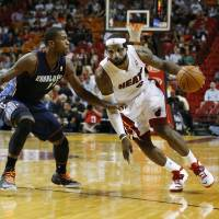 Night to remember: Miami's LeBron James drives on Charlotte's Michael Kidd-Gilchrist in the second half on Monday. | REUTERS