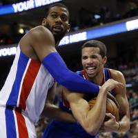 New dawn: Philadelphia's Michael Carter-Williams (right) tries to keep the ball from Detroit's Greg Monroe on Saturday. | AP