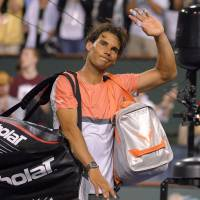 Can't win them all: Rafael Nadal waves to the crowd after his third-round loss to Ukraine's Alexandr Dolgopolov at the BNP Paribas Open on Monday in Indian Wells, California. Dolgopolov won 6-3, 3-6, 7-6 (7-5). | AP