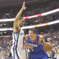 Losses racking up: Philadelphia's Michael Carter-Williams drives on Memphis' Courtney Lee in the second half on Saturday night. The Grizzles downed the 76ers 103-77. | AP
