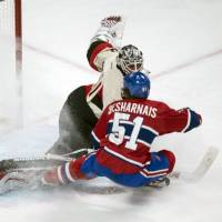 Deflected: Ottawa's Robin Lehner makes a save on a shot by Montreal's David Desharnais in the first period on Saturday. | AP