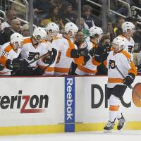 Down the line: The Flyers' Matt Read is congratulated by his teammates after scoring against the Penguins on Sunday in Pittsburgh. The Flyers won 4-3. | AP