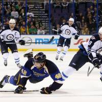 Rare play: St. Louis' David Backes (left) is awarded an empty net goal after being dropped by Winnipeg's Jacob Trouba on Monday. | AP