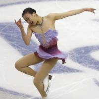 Not much competition: Mao Asada will bid for her third title at the world championships in Saitama next week against a field weakened by withdrawals following the Sochi Olympics. | AP