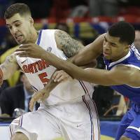 Top of the charts: Florida's Scottie Wilbekin (left) tries to keep the ball away from Kentucky's Andrew Harrison during the SEC title game on Sunday. | AP