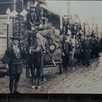 One of several enlarged photos of Mashiko in former times, this shows a delivery of straw to wrap a pottery's wares for shipment. The images are displayed on street corners and old buildings around town. | STEPHEN MANSFIELD PHOTO
