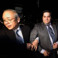 Mt. Gox CEO Mark Karpeles leaves the Tokyo District Court on Friday. | BLOOMBERG