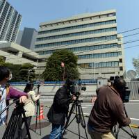 Camera crews film the exterior of the building Chongryon uses for its headquarters in Chiyoda Ward, Tokyo, on Monday. | AFP-JIJI