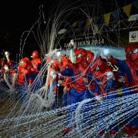 Children dressed as Spider-Man — the official goodwill ambassador of this year's Earth Hour switch-off campaign aimed at generating public awareness about global warming — cast webs Saturday evening in Yokohama, where the U.N.-sponsored Intergovernmental Panel on Climate Change met for five days through Saturday. | KYODO