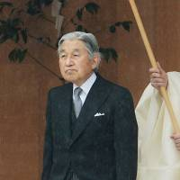 Emperor Akihito walks outside the outer shrine during a visit to Ise Shrine in Mie Prefecture on Wednesday. | KYODO