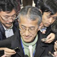 Osamu Tasaka, director general of the International Department at the Japanese Red Cross, fields reporters' questions at an airport in Shenyang, China, on Sunday. | KYODO