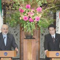Iranian Foreign Minister Mohammad Javad Zarif fields a question during a news conference with Foreign Minister Fumio Kishida following their talks in Tokyo on Wednesday. | AFP-JIJI