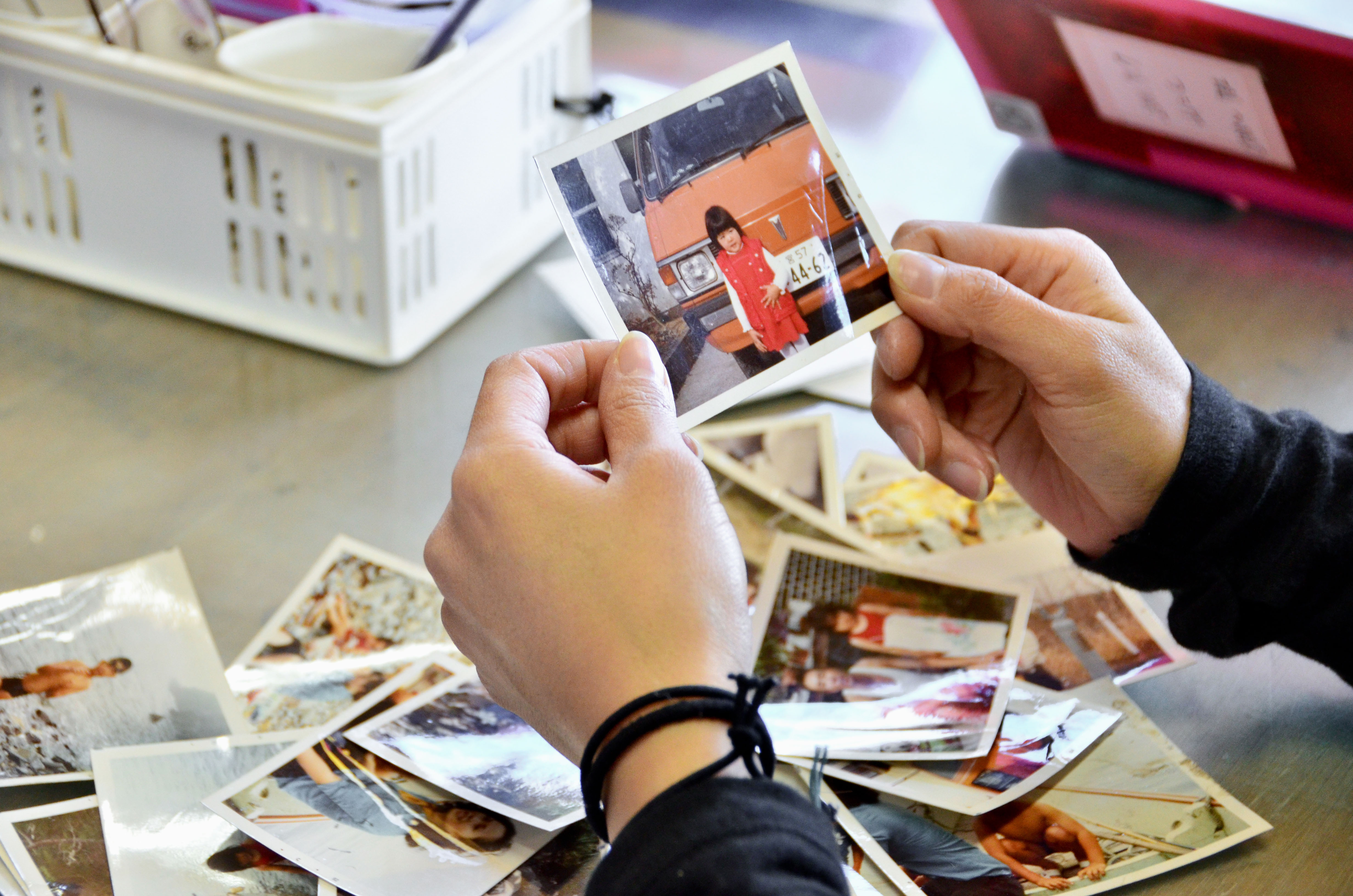 Memories: Many of the photos found after the tsunami were damaged beyond recognition — scarred by the same waters that swept away many of the people depicted in them. | LOST & FOUND PROJECT
