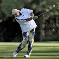 A sinking ship: John Daly hits off the seventh fairway during the second round of the Valspar Championship on Friday in Palm Harbor, Florida. | AP