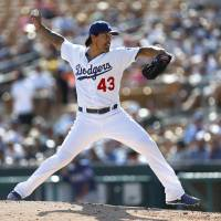 League of his own: Los Angeles' Brandon League pitches during the Dodgers' 2-1 spring training win over the Rangers on Friday. | AP