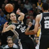 Here, you take it: San Antonio's Manu Ginobili makes a pass during San Antonio's 133-102 win over the Nuggets on Friday. | AP