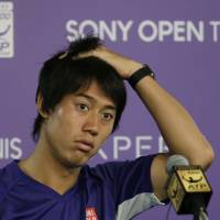 Can't go on: Kei Nishikori listens to a question during a news conference after pulling out of the Sony Open on Friday in Key Biscayne, Florida. | AP