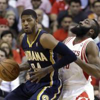 Too close for comfort: The Pacers' Paul George drives on the Rockets' James Harden in first-half action on Friday in Houston.   AP