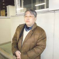 Satoshi Hosokawa and Masashi Nishimura are self-described 'Aumers' who say they admire and sympathize with the convicted cultists. | TOMOHIRO OSAKI