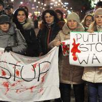 Poles demonstrate in front of the U.S. Embassy in Warsaw on March 6 to demand sanctions against Russia over its military incursion in Ukraine's Crimea region. | AP
