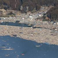 A fishing port in Ishinomaki, Miyagi Prefecture, is seen on March 12, 2011, a day after it was wiped out by the huge tsunami.   KYODO