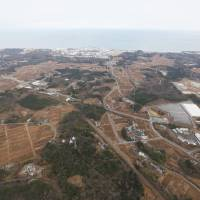 The Fukushima No. 1 nuclear plant and the area around the town of Okuma are seen in December. | KYODO
